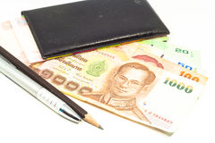 Workplace , notebook with money and a pen isolated Stock Image