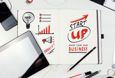 Workplace. Notepad with  Start Up lettering Royalty Free Stock Photography