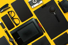 Workplace with office items and business elements on a desk. Con. Workplace with office items and business elements on a yellow background. Concept for branding Royalty Free Stock Photography
