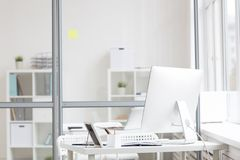 Workplace in office. Workplace of modern manager with computer monitor and office supplies Royalty Free Stock Images