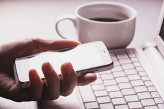 Workplace in the office. smartphone in the hand Royalty Free Stock Photo