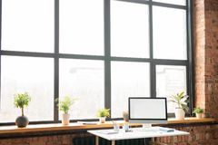 Workplace by office window royalty free stock photo