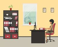 Workplace of an office worker. The young woman is an employee at work. There is a black furniture: a desk, a cabinet for documents, red chair and other objects Royalty Free Stock Photography