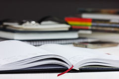 Workplace with open a business diary. empty space for text. Royalty Free Stock Images
