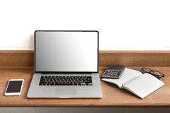 Workplace with open laptop with black screen on modern wooden de stock images