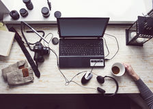 Workplace with open laptop with black screen  on modern wooden desk Royalty Free Stock Photos