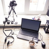Workplace with open laptop with black screen  on modern wooden desk Stock Photos