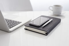 Workplace with open laptop, diary, mobile phone Royalty Free Stock Photos