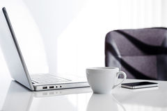 Workplace with open laptop, mobile phone Royalty Free Stock Image