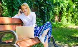 Workplace outdoors. Working outdoors. Freelance lifestyle advantages. Casual and part time outdoor jobs. Girl sit bench. With notebook. Woman with laptop works stock photo