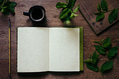 The workplace painter  and green leaves. The  presentation. The blank notebook. Spring time blank notebook. Royalty Free Stock Photos