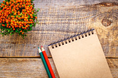 Workplace painter with watercolor pencil and open notebook Royalty Free Stock Photography