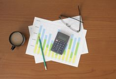 Workplace with pen and paper with graphs Stock Photography