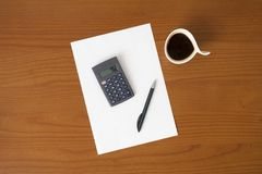 Workplace with pen and paper with graphs Royalty Free Stock Image