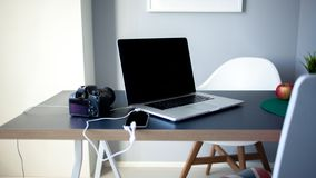 Workplace photographer and designer, laptop with camera and smartphone on the table. royalty free stock photos