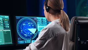Workplace of the professional air traffic controller in the control tower. Female aircraft control officer works using