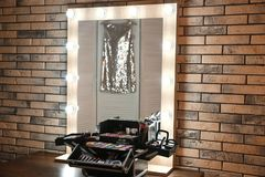 Workplace of professional makeup artist with   mirror and cosmetic. Workplace of professional makeup artist with large mirror and cosmetic Stock Photos