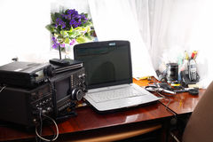 Workplace radio amateur. Workplace amateur radio transceiver and a laptop stock image