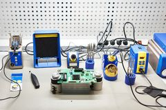 Workplace with soldering iron and tool for electronic. Workplace with a soldering iron and a tool for electronics and components royalty free stock image
