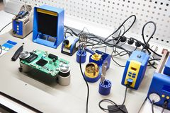 Workplace with soldering iron and tool for electronic. Workplace with a soldering iron and a tool for electronics and components stock images