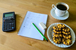 Workplace, study place with calculator, workbook, cup of coffee Stock Photo