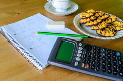Workplace, study place with calculator, workbook, cup of coffee Royalty Free Stock Photography