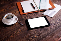Workplace. Tablet. Notepad. A cup of coffee on the table Royalty Free Stock Photography