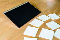 Workplace with tablet pc and several sticky notes Royalty Free Stock Photo