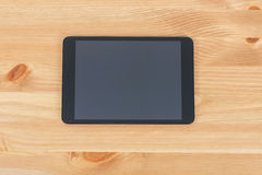 Workplace with tablet on a wooden work table.  royalty free stock photo