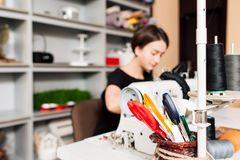 Workplace of tailor. scissors and thread Stock Image