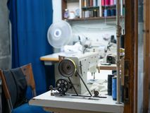 Workplace of tailor seamstress needlewoman sewing machine royalty free stock photography