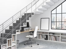 Workplace under the stairs. Workplace with a computer under the stairs, window to the right. City view. A blank frame under the stairs. Concept of work. 3D Royalty Free Stock Photo