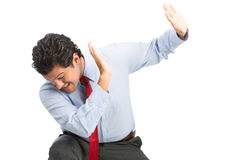 Workplace Verbal Physical Violence Hispanic Man. A male hispanic victim white collar office worker protecting himself with hands up in defensive position from stock photos
