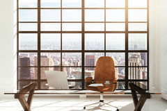 Workplace in a white modern interior with city view Royalty Free Stock Photo