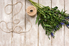 Workplace with wildflower and rope flat lay Royalty Free Stock Photo