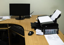Workplace with wood table, computer, printer, monitor, mouse Royalty Free Stock Image