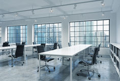 Workplaces in a bright modern loft open space office. Empty tables and docents' book shelves. Singapore panoramic view. A concept. Of a high quality consulting Stock Photography