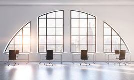 Workplaces in a bright modern open space loft office. White tables and black chairs. New York city view. 3D rendering. Stock Photo