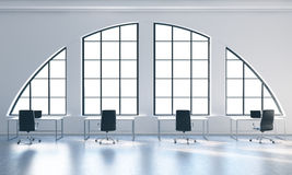 Workplaces in a bright modern open space loft office. White tables and black chairs. White copy space in the panoramic windows. 3D Stock Photo