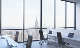 Workplaces in a bright modern open space office. Stock Photos