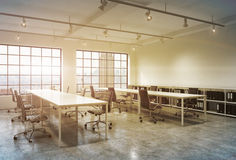 Workplaces in a bright sunset loft open space office. stock illustration