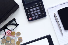 Workplaces, diary with calculator and money Stock Images