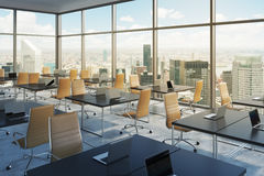 Workplaces in a modern corner panoramic office, New York city view, Manhattan. Open space. Black tables and brown leather chairs. A concept of financial Stock Photography
