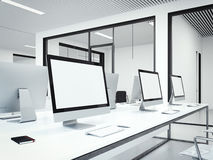 Workplaces in modern office interior. 3d rendering. Workplaces with blank displays in modern office interior. 3d rendering Royalty Free Stock Image