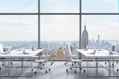 Workplaces in a modern panoramic office, New York city view from the windows. A concept of financial consulting services. 3D rendering Stock Photo