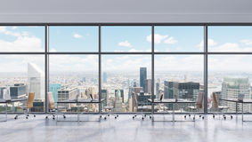 Workplaces in a modern panoramic office, New York city view in the windows, Manhattan. Open space. Black tables and brown leather chairs. A concept of Royalty Free Stock Photos