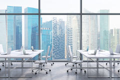 Workplaces in a modern panoramic office, Singapore city view from the windows. A concept of financial consulting services. 3D rend Stock Photography