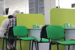 Workplaces in a row. Workplaces for receiving customers in the bank abreast. service pensioners and elderly people in the bank. soft focus. blur Stock Photo