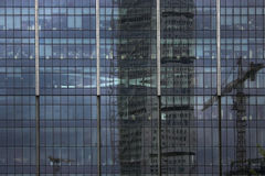 Works. A building with offices and reflection of another building with work instruments Royalty Free Stock Photography
