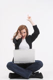 It works!. One young businesswoman is sitting on the floor with her laptop and rejoice Royalty Free Stock Photos